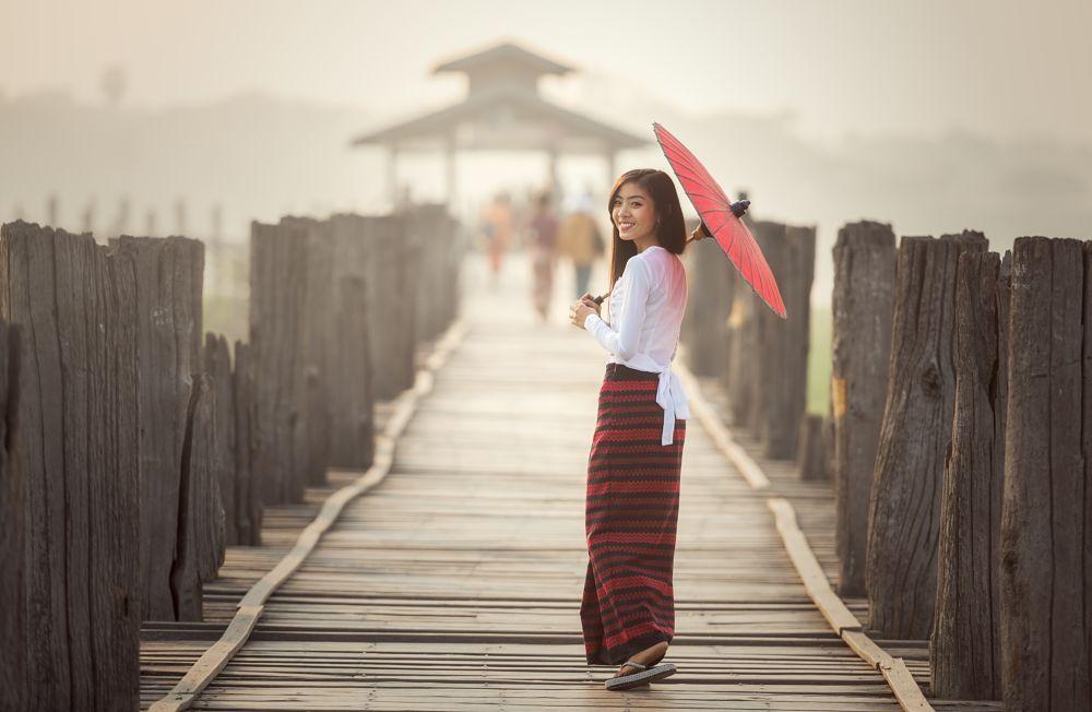 Photo in Portrait #burmese #woman #traditional #umbrella #bridge #u bein #myanmar #people