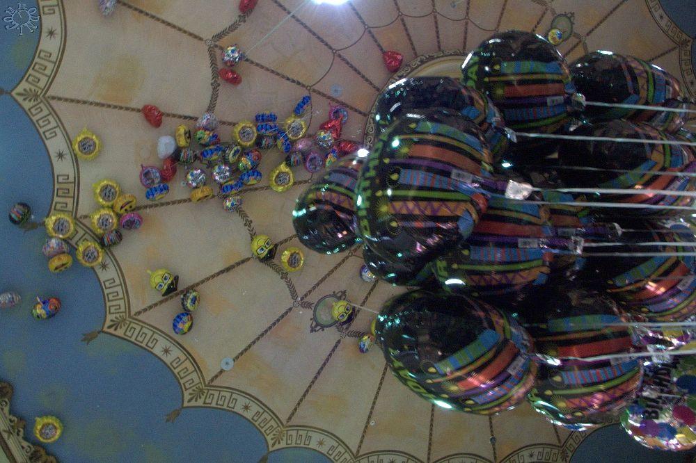 Photo in Cityscape #balloons #dollar store #happy face #escape