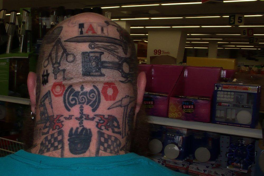 Photo in Cityscape #tattoo #dollar store #small format #rodnidotcom #head #metal work
