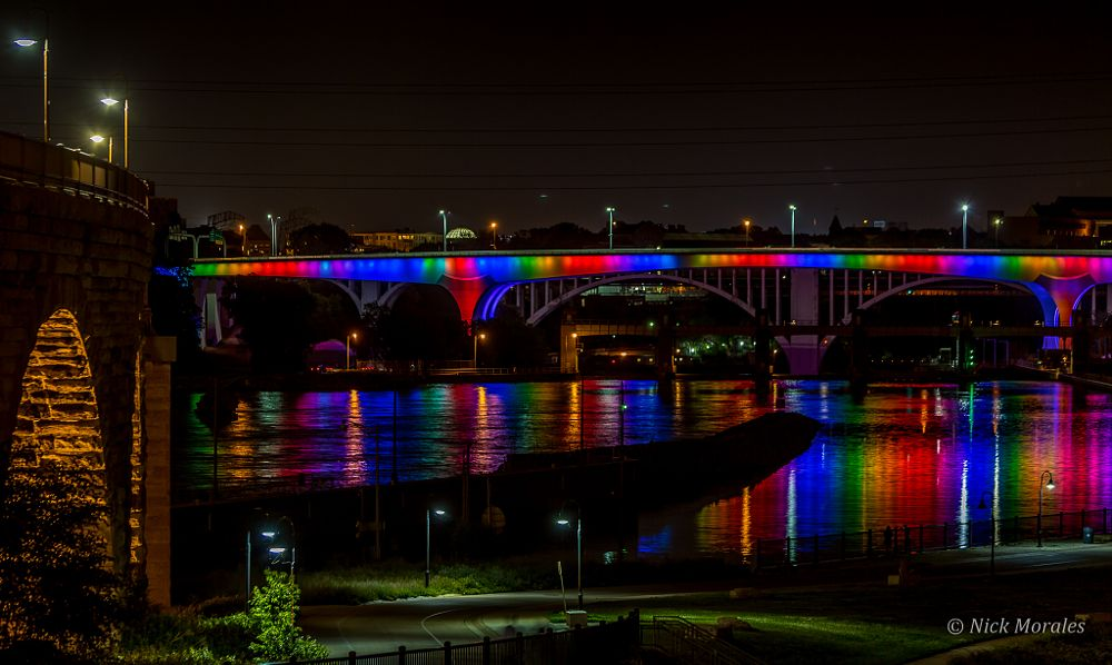 Photo in Architecture #bridge #rainbow #minneapolis #reflection #vibrant #river #long exposure #night