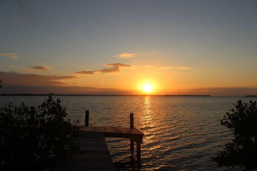 Photo in Sea and Sand #sunrise #dock #ocean