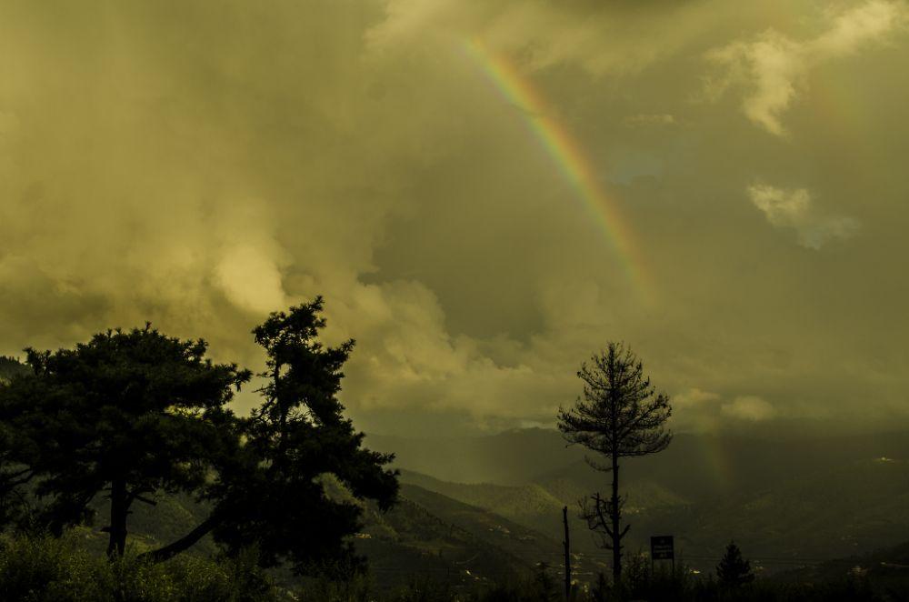 Photo in Nature #rainbow #clouds #rain #bhutan