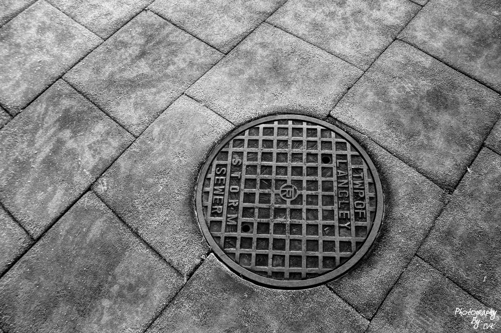 Photo in Black and White #black and white #playground #langley #sewer #drain