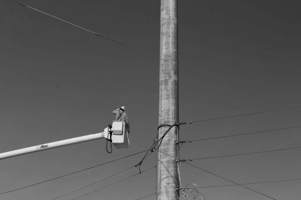 Photo in Black and White #crane #construction #worker #thinking