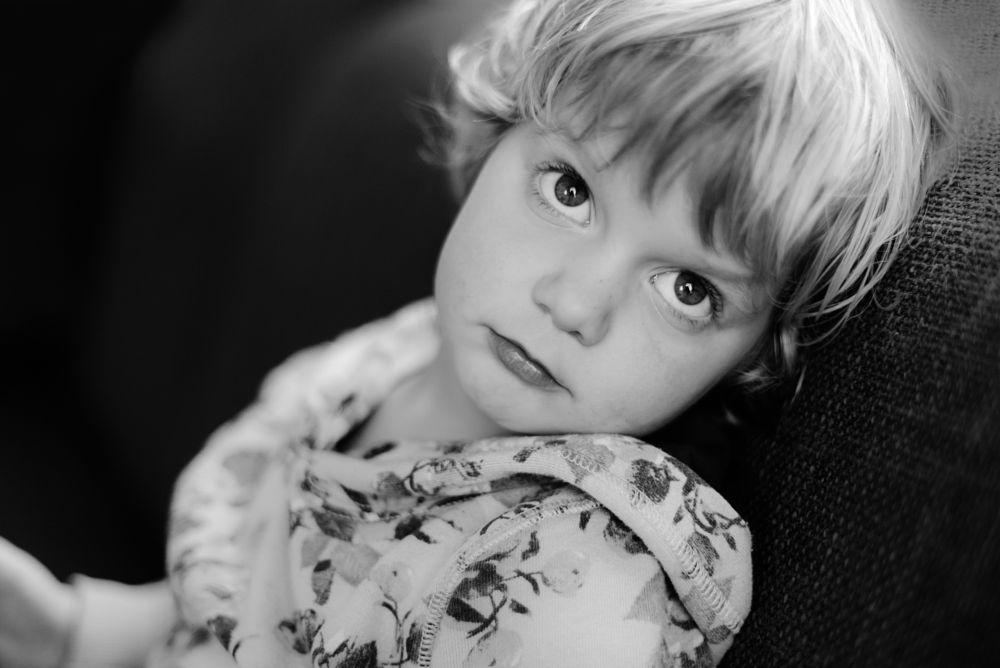 Photo in Portrait #nikon #50mm #blackandwhite #girl #staring #child #childhood #naturallight