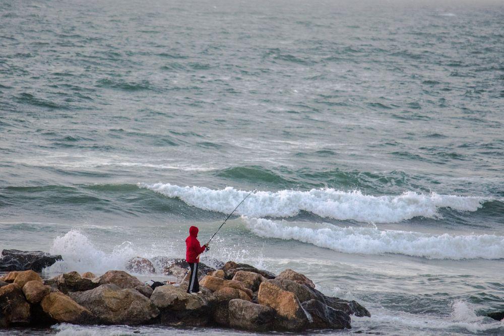 Photo in Sports #fisherman #sea #wave