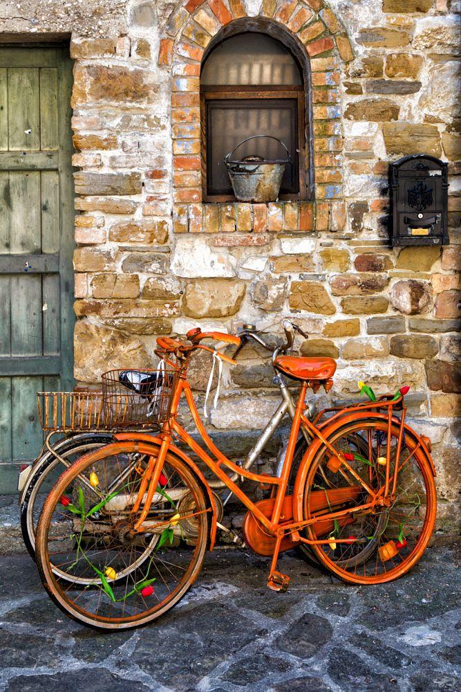 Photo in Street Photography #grado #italy #bicycle #bike #orange #street #urban #wall #facade #quirtmair