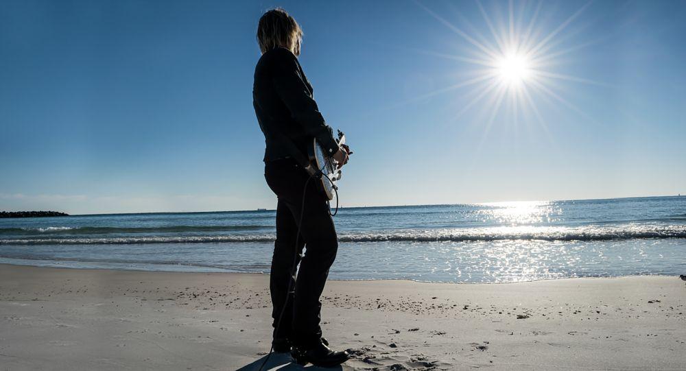 Photo in Portrait #beach #sun #guitarist #guitar #black #standing #posing #portrait #person #man #blue sky #sand #ocean #water #florida #bright