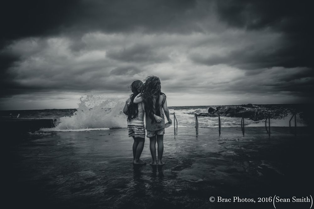 Photo in Black and White #sisters #twins #love #cayman islands #waves #clouds #candid photography #best friends