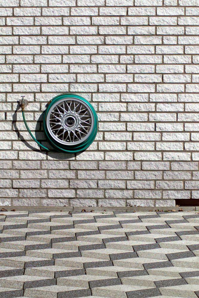 Photo in Abstract #wall #bricks #wheel #lines