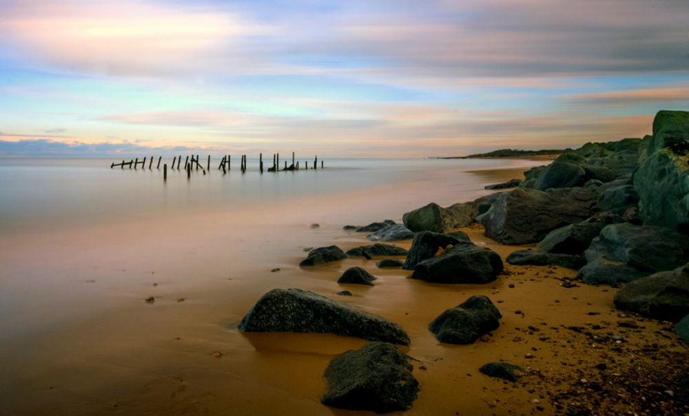 Photo in Sea and Sand #happisburgh #norfolk #beach #rock #sea #ocean #water #seascape #long exposure #10 stop filter #groynes #sand #stones #sky #clouds #movement #coast #seashore