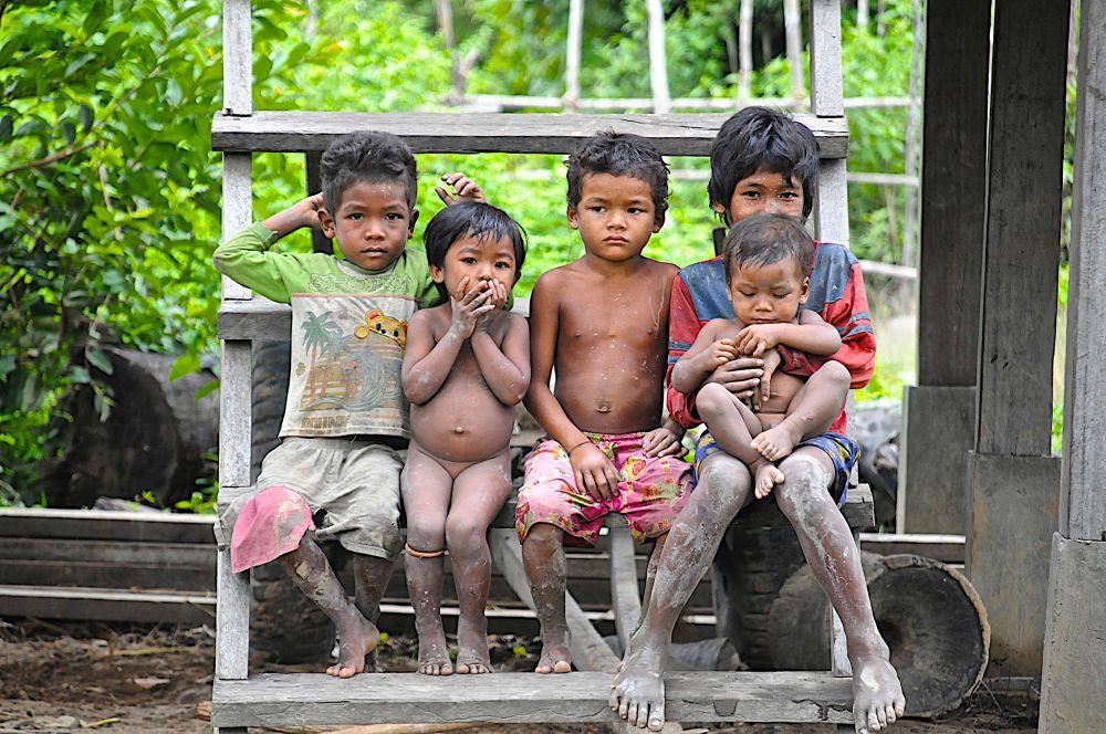Photo in People #cambodia #jungle outreach #children #mud #rain #steps