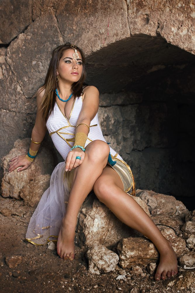 Photo in People #female #cavern #stones #dress #seated
