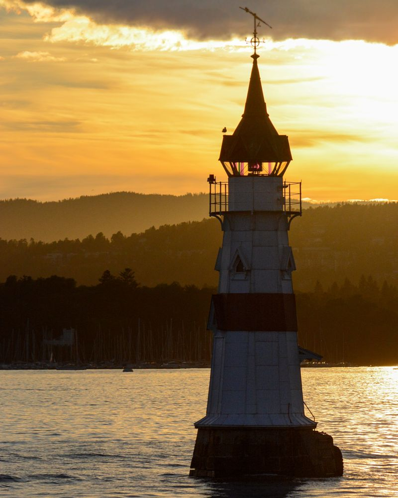 Photo in Sea and Sand #lighthouse #sea #water #sunset #golden hour #hills #layers