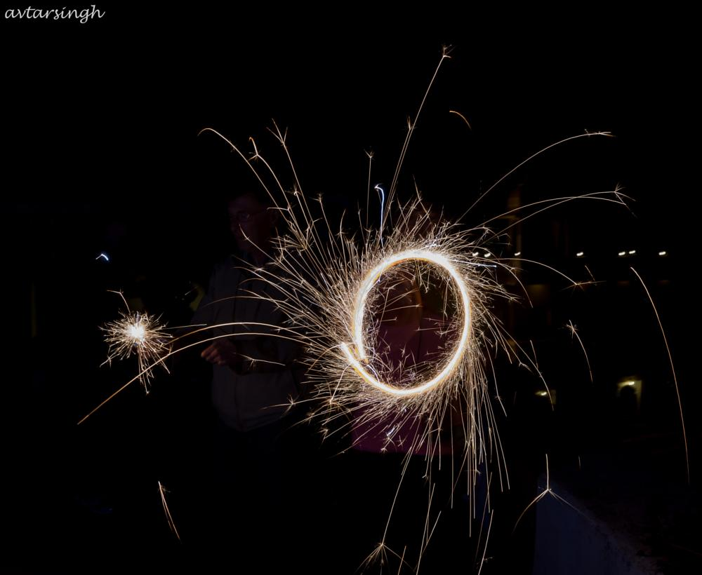 Photo in Abstract #sparkles #light painting #people #night shot #festivity