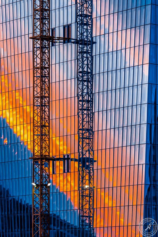 Photo in Cityscape #sundown #mirror #facade #glas #bank #crane #frankfurt #germany #euro #ezb #sun #sonnenuntergang #spiegelung #architecture #city #cityscape