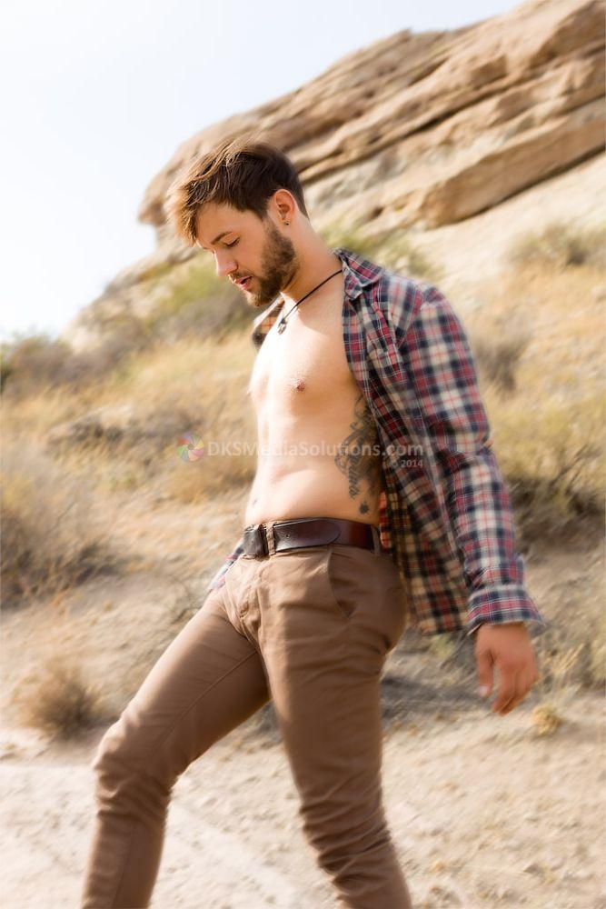 Photo in Portrait #model #male model #matt mosby #david k. smith #dks media solutions #vasquez rocks #nature #desert #open shirt #plaid shirt #brown pants #leather belt