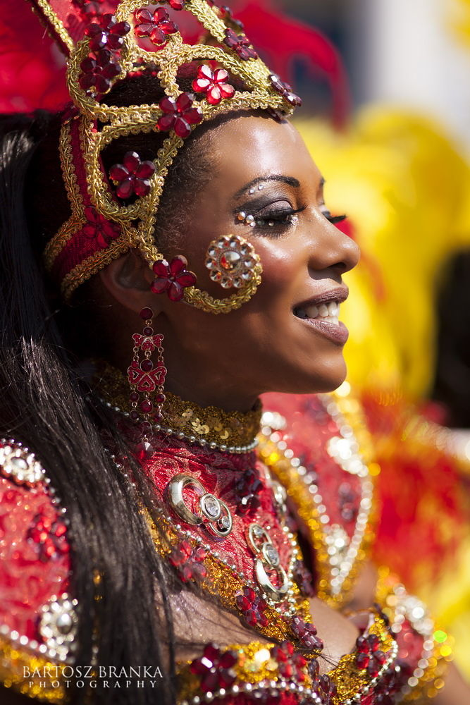 Photo in Portrait #woman #portrait #carnival #london #outdoor #color #red #fun #smile