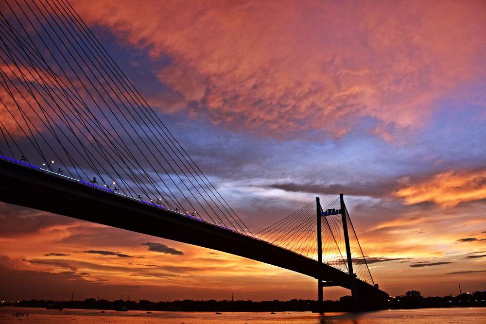 Photo in Landscape #dramatic_sky #sunset #skyscape #bridge #landscape #architecture #colourful_sky