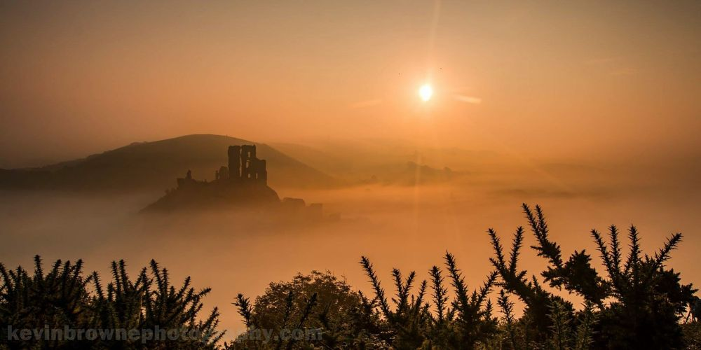 Photo in Landscape #mist #sunrise #corfe castle #dorset #ancient #classic #orange #jurassic #climb #kevinbrownephotography #england