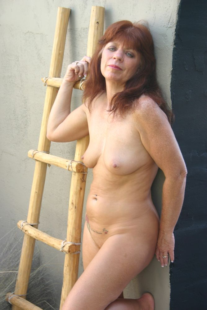 Photo in Nude #red head #mature #nude #playing with hair #figure #body #sexy?