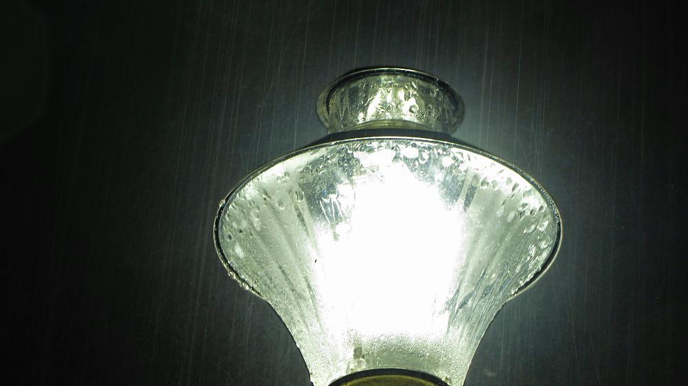 Photo in Cityscape #lamp with rain #lamp #rain