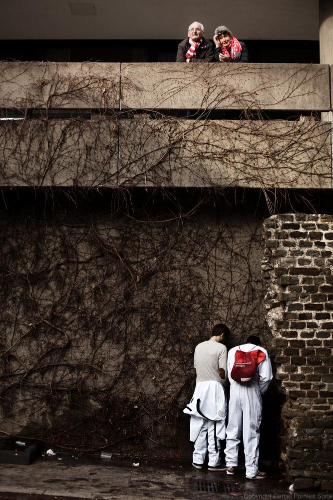Photo in Street Photography #dirty #cologne #carnival #pee #pissing #couple #contemplation #irony #ironic #peeing #street