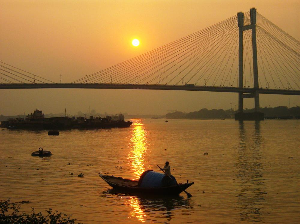 Photo in Cityscape #vessel #bridge #river #sunset #reflection