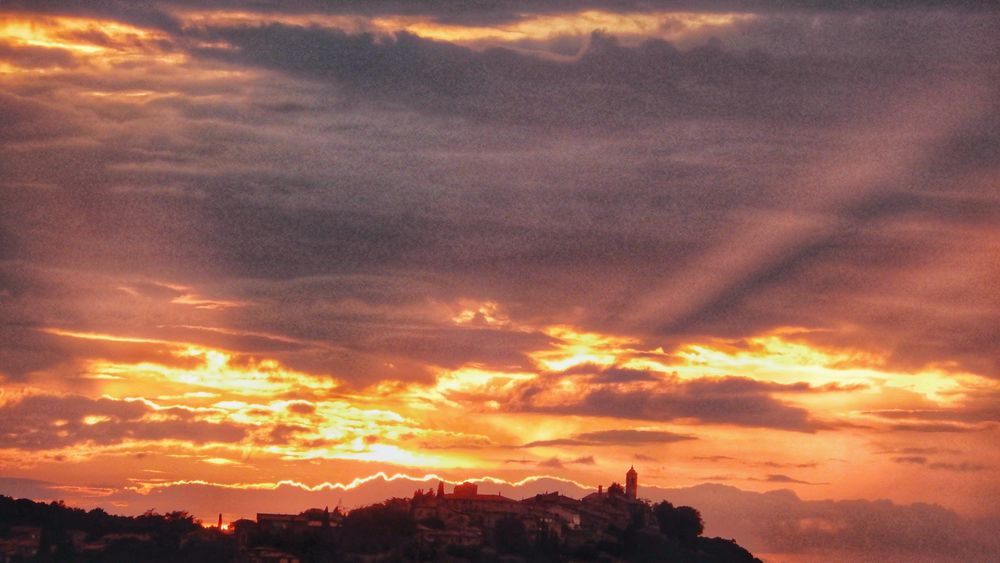 Photo in Nature #nature #sunset #silhouette #village #cloud #ray of sun #colorful #tuscany #travel