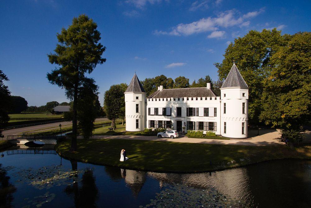 Photo in Wedding #wedding #netherlands #castle #bride #groom #drone
