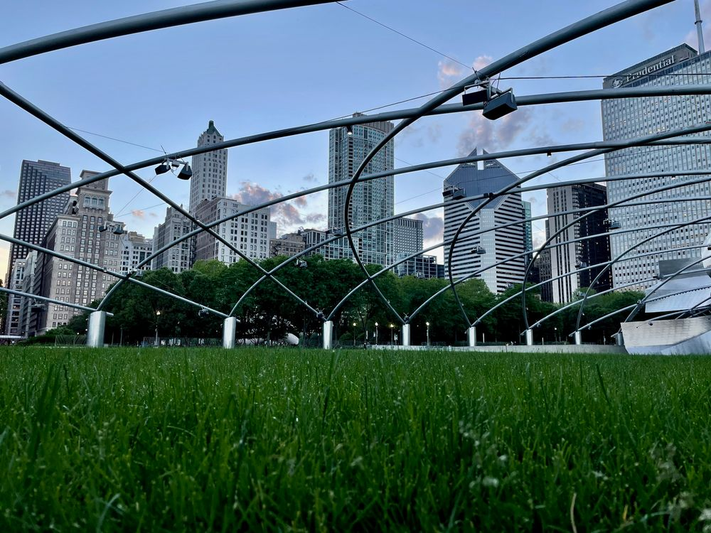 Photo in Landscape #low angle #no people #outside #city #skyline #skyscraper #park #millennium park #chicago #downtown #sunset #summer #evening
