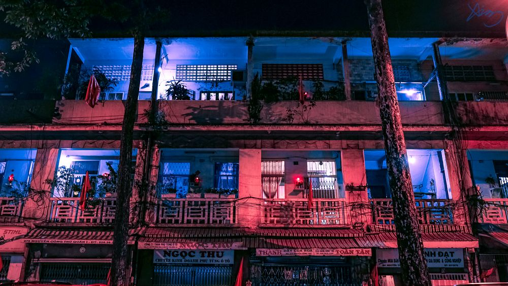 Photo in Street Photography #building #lights #neon #old #abandoned #night #poor #life #red #blue #street