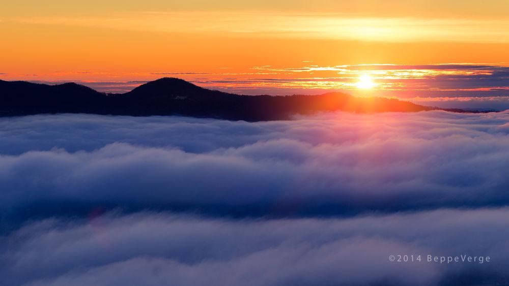 Photo in Landscape #dawn #sunrise #clouds #sun #nuvole #alba #madonna del sasso #sole #sunrise over the clouds
