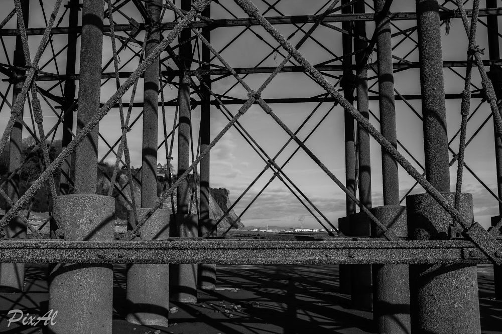 Photo in Black and White #metal #struts #cross #construction #stress #beach #victorian #seaside #pier #penarth #shadows #patterns #monochrome