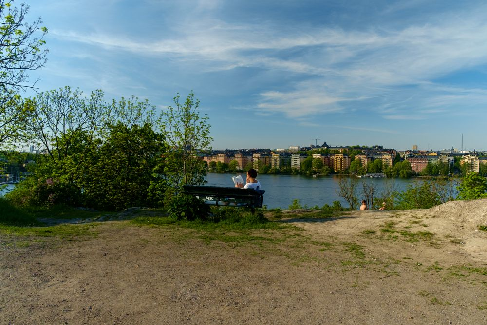 Photo in Travel #stockholm #sweden #reading #woman #city #cityscape #town #river #riverbank #lake #water #capital #architecture #urban #nature #park #travel #fuji #fujinon #fujifilm #fuji x-e1 #raw #lightroom #postprocessing #people #capture