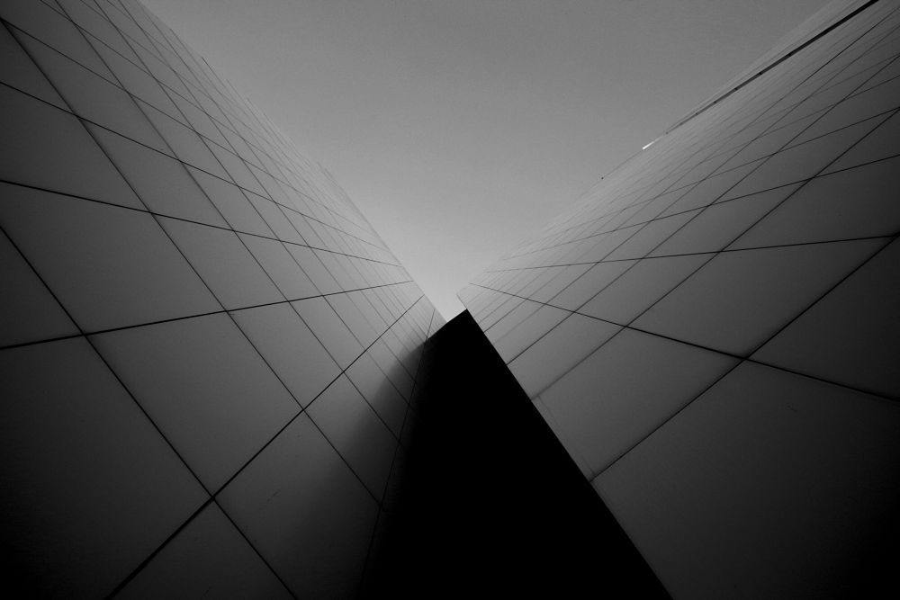 Photo in Abstract #architecture #building #facade #no windows #upwards #black and white #b&w #low-key #abstract #minimal