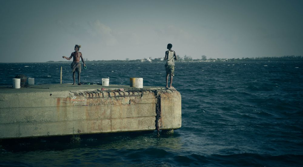 Photo in Landscape #kingston #downtown #water #front #jamaica #fishermen #divers