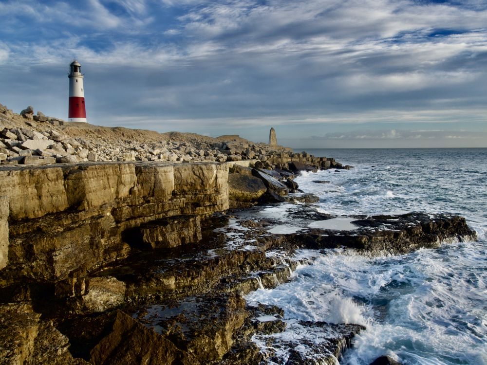 Photo in Landscape #windy #stormy #white water #cliffs #island #waves #rocks #rocky #sea #water #clouds #cloudscape #lighthouse #obelisk