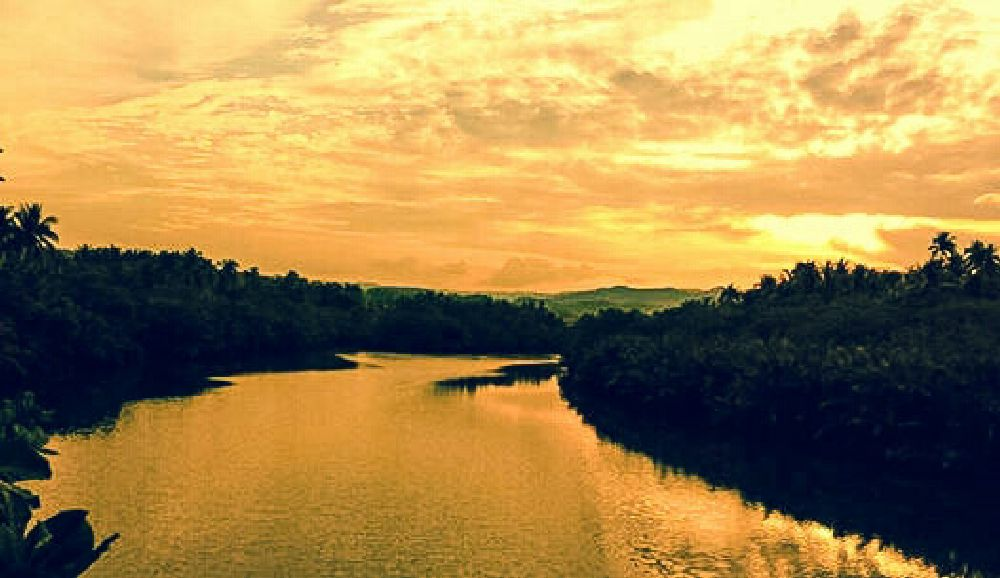 Photo in Landscape #sunset #gold #loom #river #borongan #city #eastern #samar #philippines #reflections