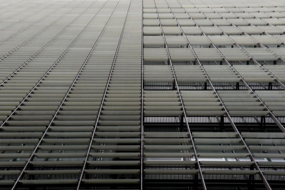 Photo in Architecture #architecture #facade #building #highrise #skyscraper #residential #housing #windows #structure #lines #cladding #blackandwhite #b&w #ubran #city #impressive #light #escalators #modern #business #glass #symmetry #symmetrical #lights #patterns