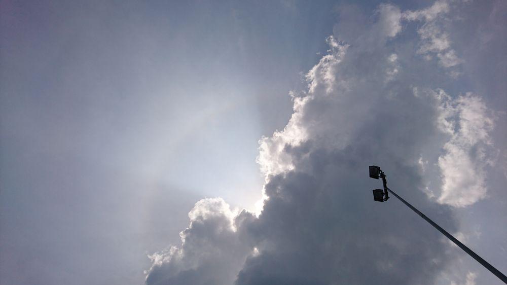 Photo in Nature #hiddensun #singlelamppost #lamppost #sunray #hiddenbehindclouds #sky #lookuptothesky #beautifulsky