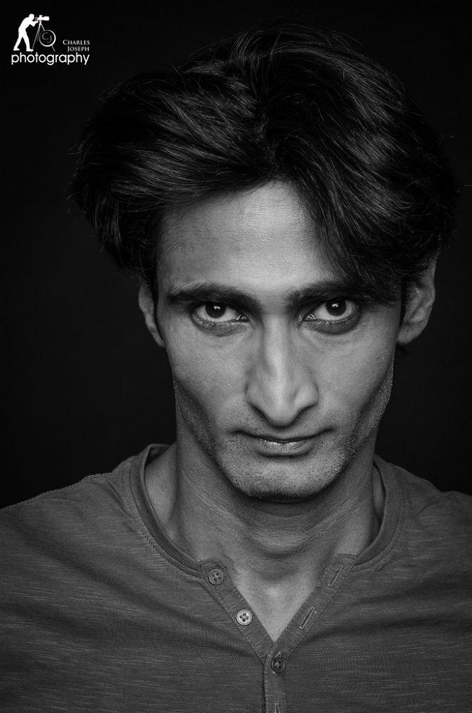 Photo in Portrait #portrait #male #close up #black & white #black #50mm #nikon d7000 #guy #boy