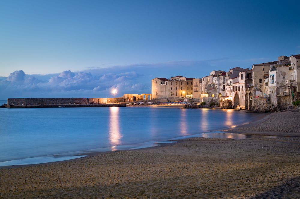 Photo in Cityscape #sunset #blue hour #cefalu #sicily #italy #evening #calm #long exposue #city #town #village #coast #meditarranean #sea #ocean #beach #lights #travel #romantic
