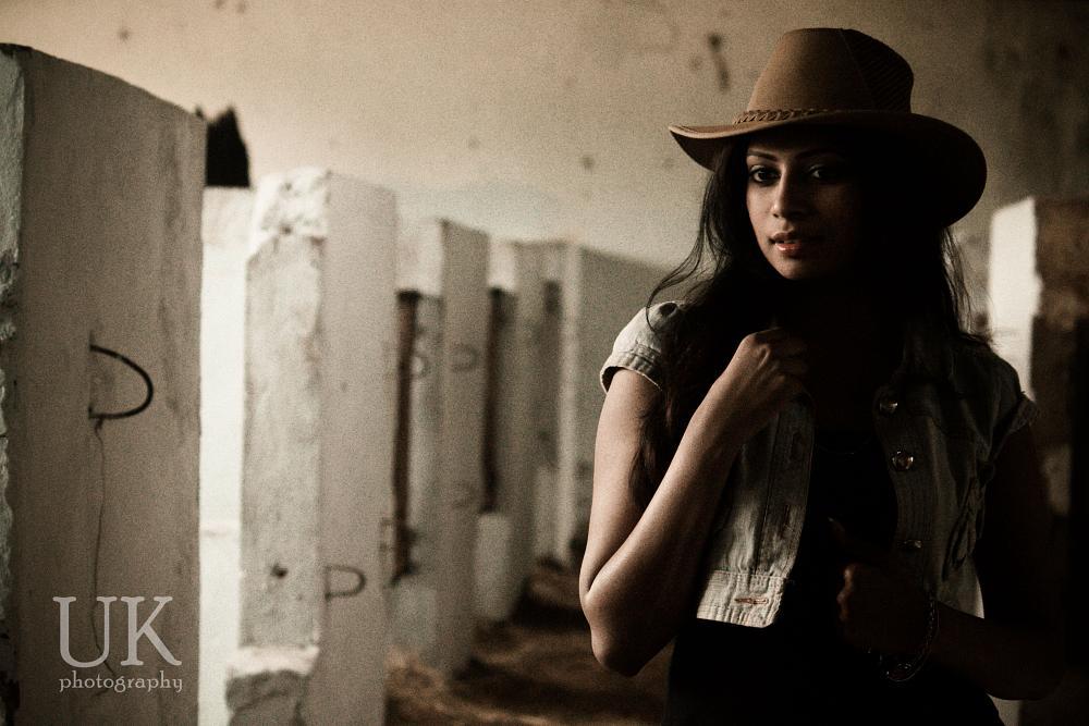 Photo in Fashion #indian model #denim jacket #fashion #cowboy hat #horse stable #natural light #portrait photography