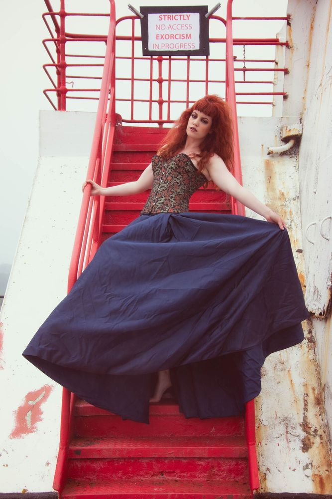 Photo in Fashion #beauty #corset #fashion #female #long hair #model #portrait #redhead #ship #skirt #stairs #woman