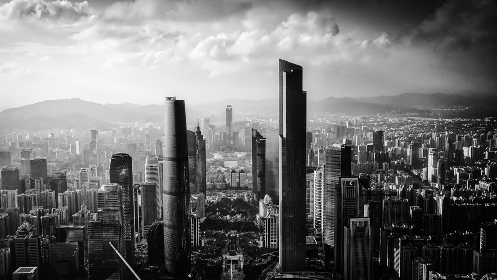 Photo in Cityscape #cityscape #architectures #skyline #top #view #urban exploration #guangzhou #city #downtown view #black and white #structures #skyscrapers #highrise #mountain view #sky and clouds