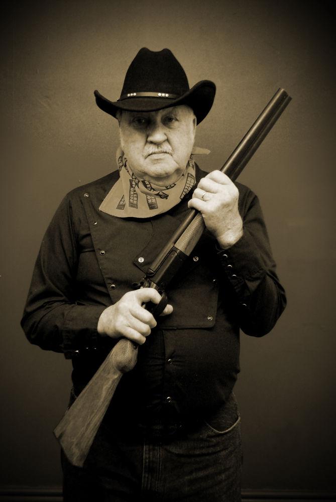 Photo in Vintage #old #cowboy #shotgun #grin #frawn #scarf #western union