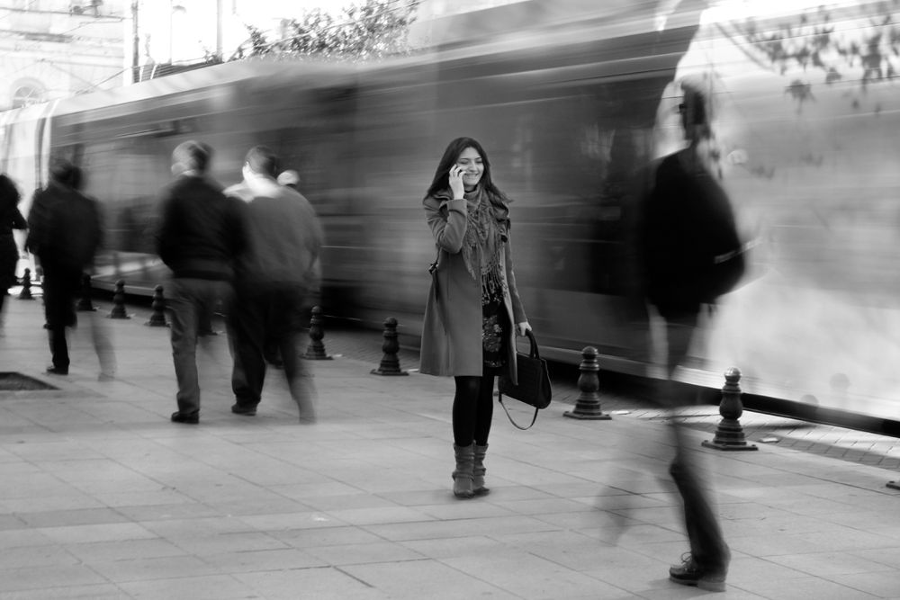 Photo in Street Photography #girl #talk #phone #tram #moving #bw