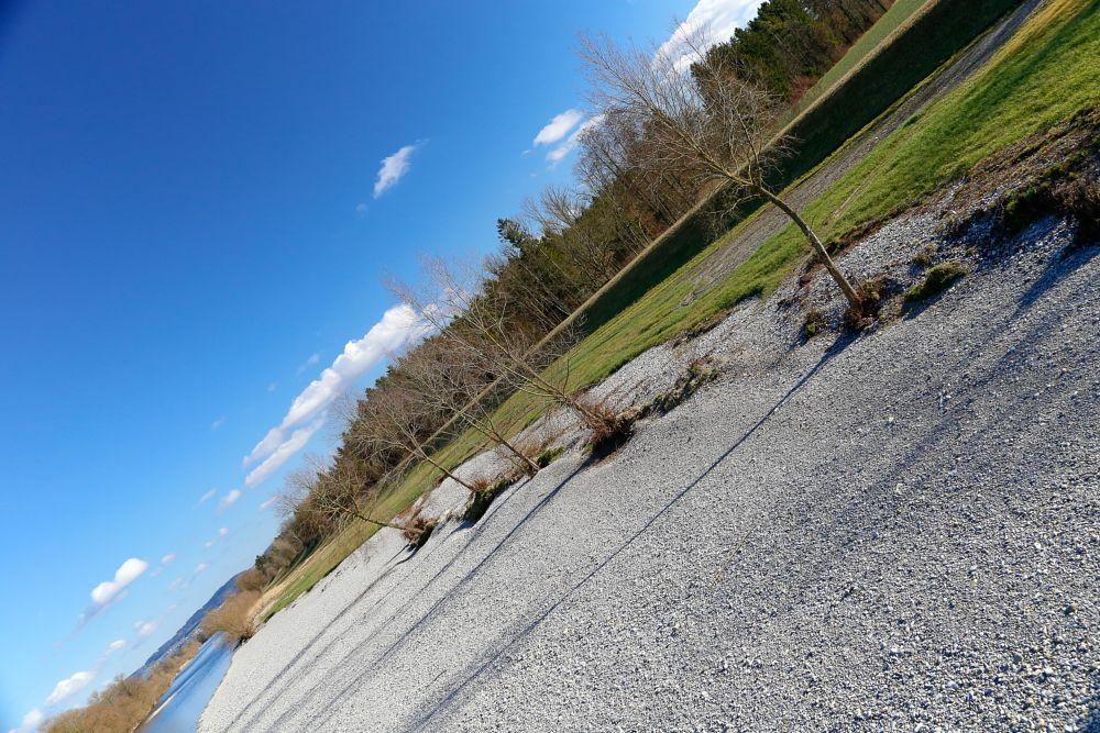 Photo in Landscape #river #switzerland #riverside #dam #gravel #angular #adrianbertschiphotography #blue sky #clouds #tress #forest #green gras