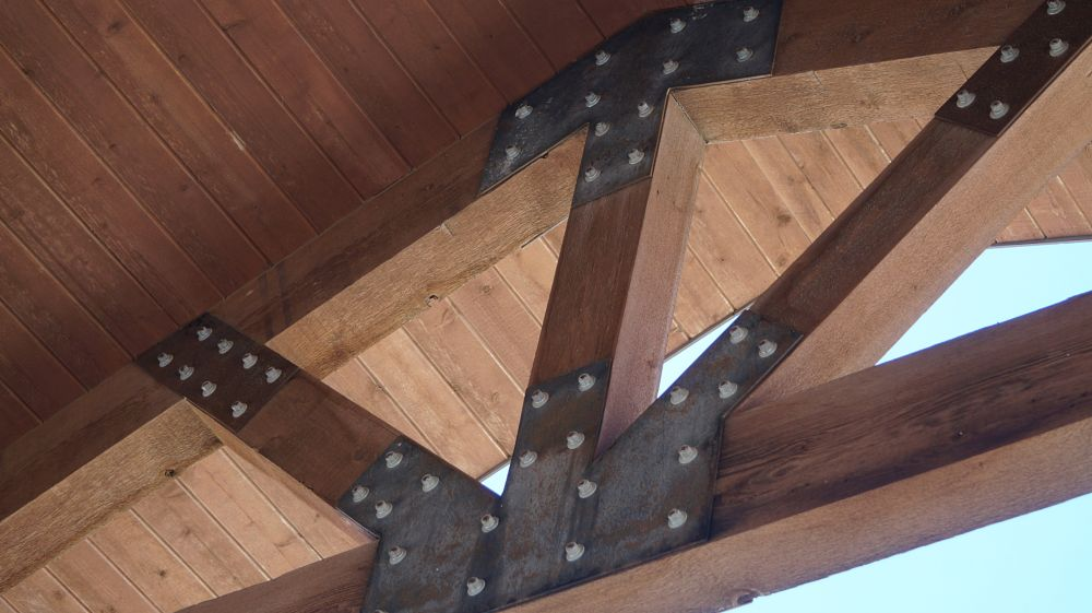 Photo in Architecture #exterior #architecture #beams #wood #steel #metal #bolts #texture #building